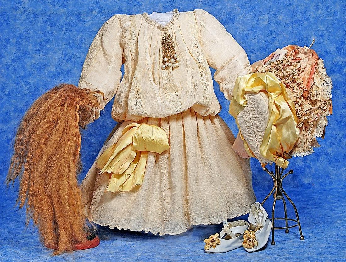 259. DOLL DRESS, BONNET, SHOES AND WIG. Ensemble sized
