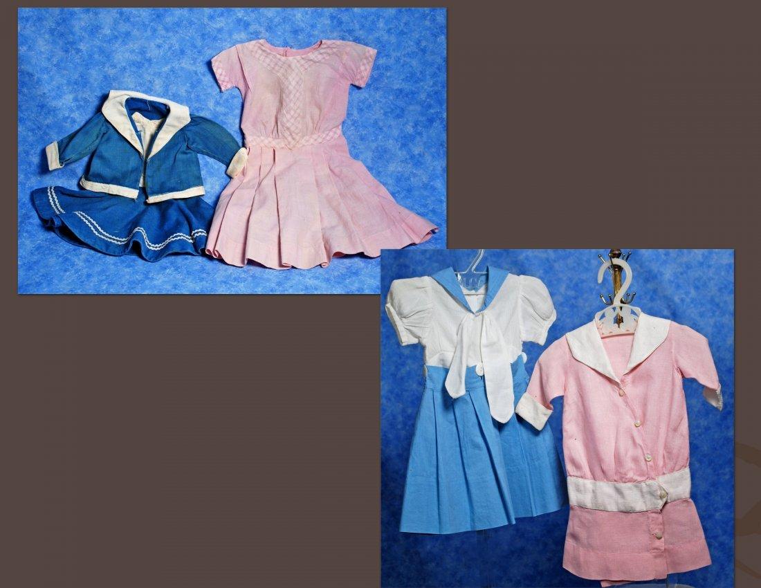 FOUR COTTON DOLL DRESSES.