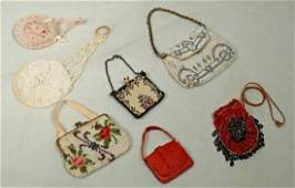 139. SEVEN DOLL PURSES. One red leather purse, one