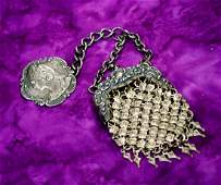 48. ANTIQUE SILVER PURSE WITH EMBOSSED EMPRESS