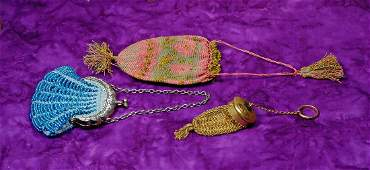. TWO DOLL PURSES AND RETICULE. Includes: 3""