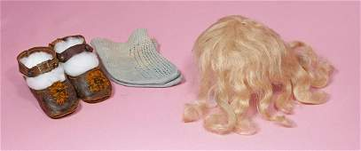 132. PAIR OF ANTIQUE DOLL SHOES AND SOCKS. Brown