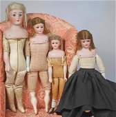 FOUR GERMAN BISQUE DOLLS BY SIMON & HALBIG Marks: S H