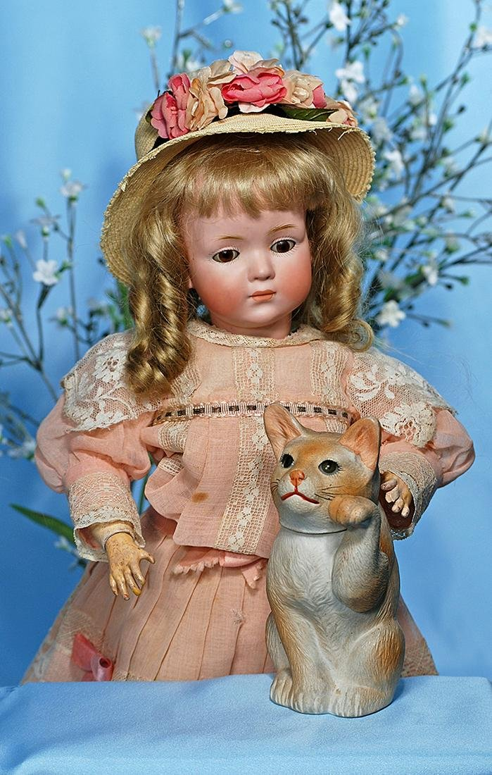 ANTIQUE GERMAN ALL-BISQUE KITTEN AS CANDY CONTAINER.