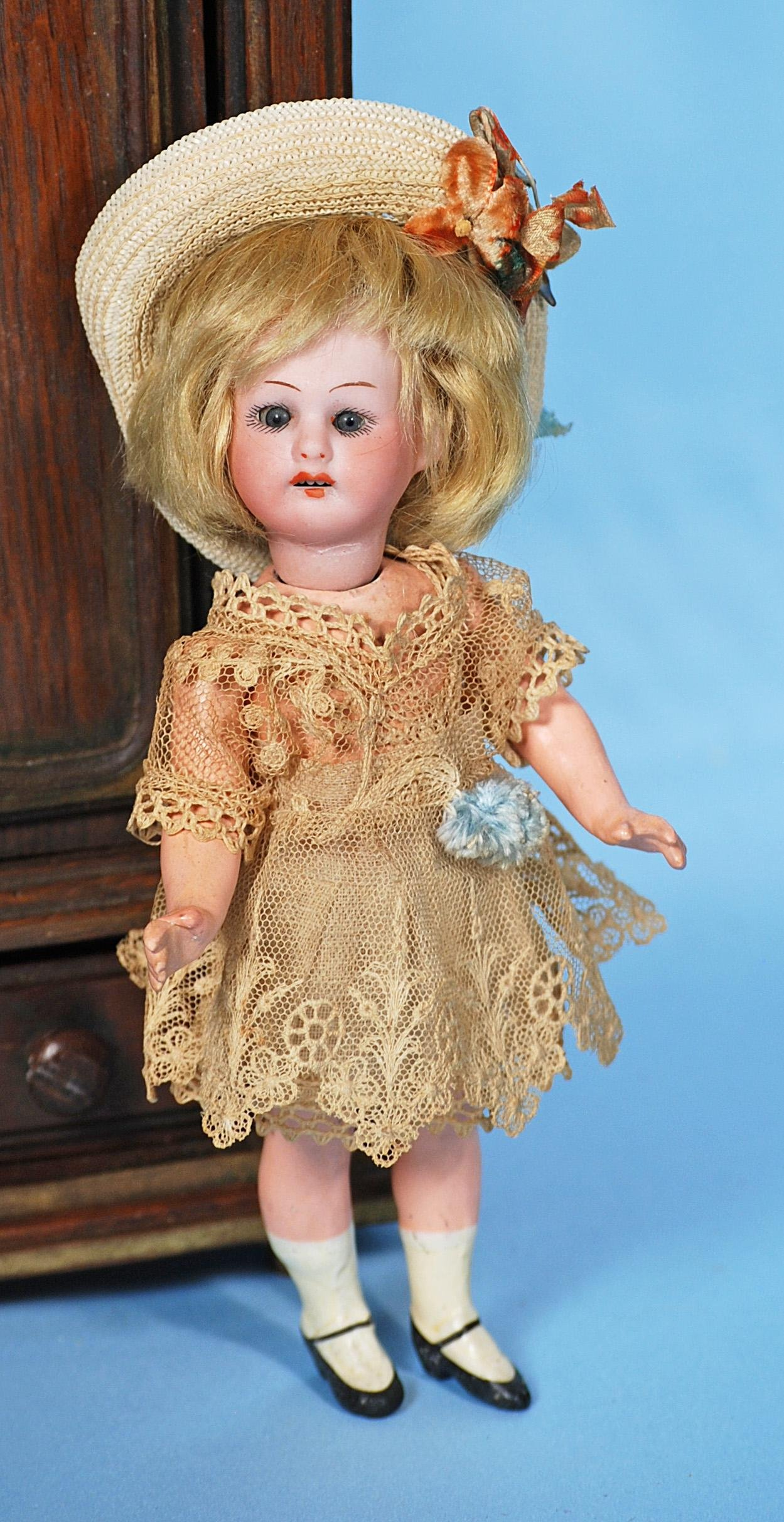 PETITE GERMAN BISQUE DOLL.  Marks: Made in Germany