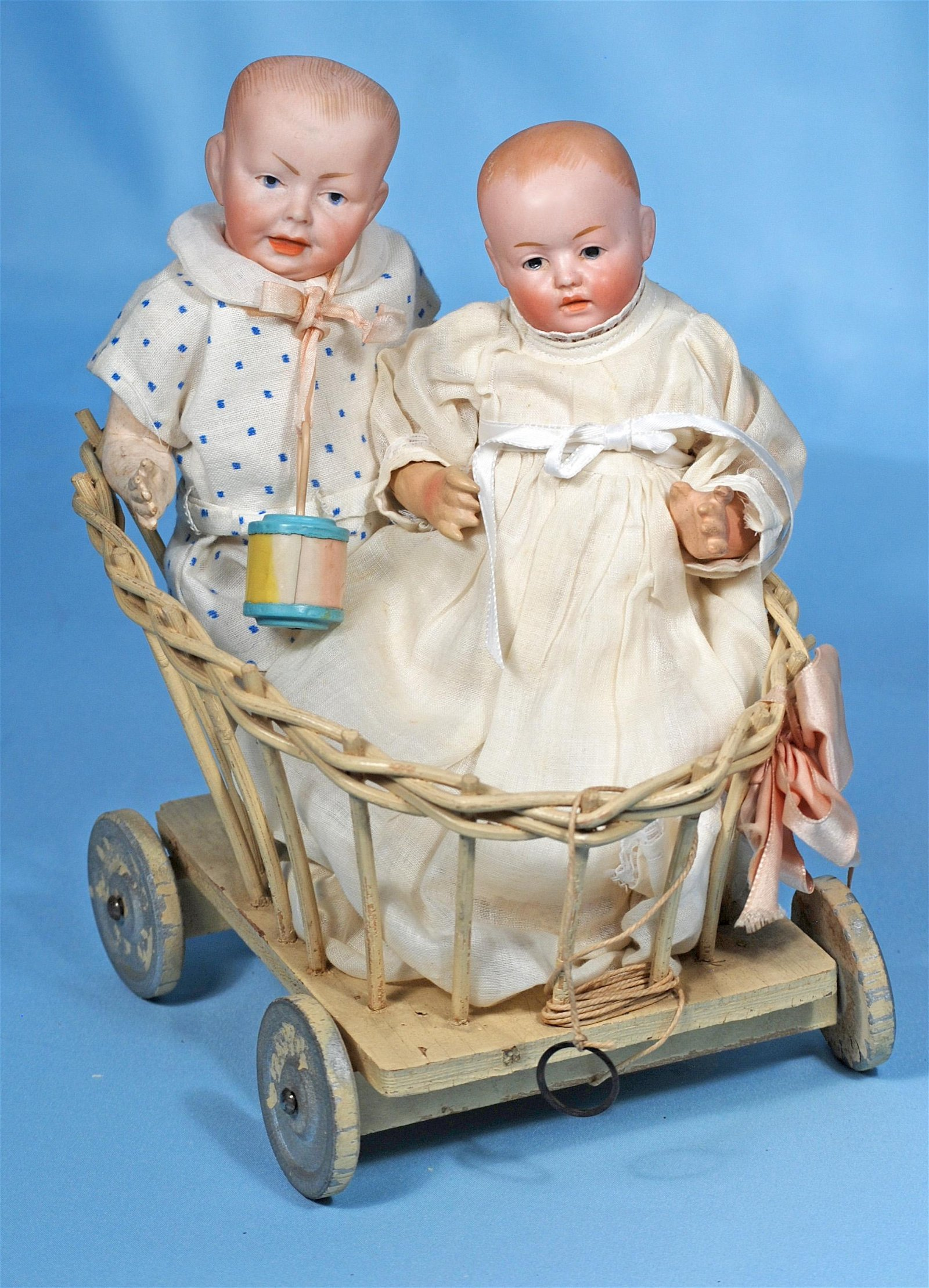 TWO PETITE GERMAN BISQUE CHARACTER BABIES IN ANTIQUE