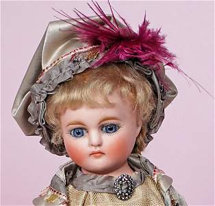 PETITE GERMAN BISQUE CLOSED-MOUTH DOLL.