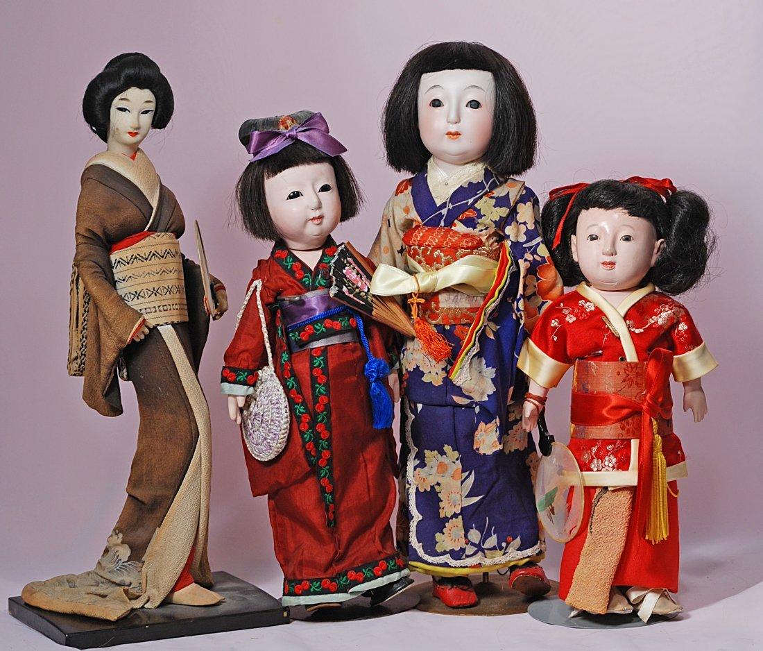 FOUR JAPANESE DOLLS