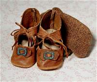 PAIR OF ANTIQUE DOLL SHOES WITH SOCKS