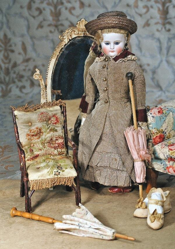 "2: ANTIQUE DOLL'S CHAIR. 8"" H. Bamboo arm chair has"