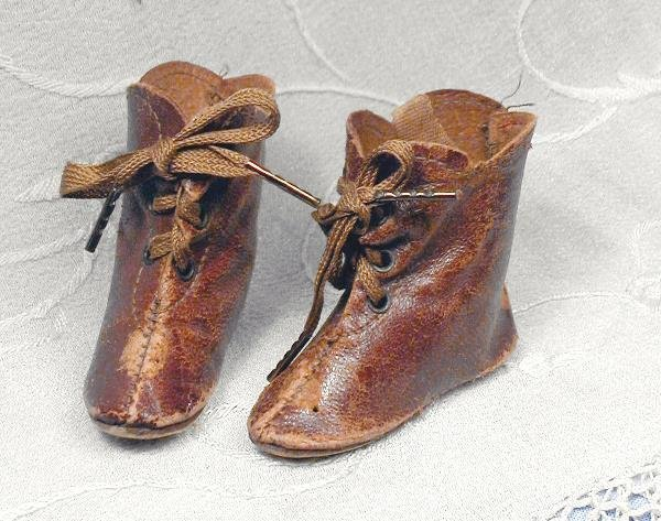 """39: PAIR ANTIQUE BROWN LEATHER DOLL BOOTS. 2 ¼"""" L.,"""
