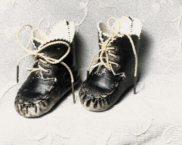 """40: PAIR OF CHARCOAL LEATHER DOLL BOOTS. 2 ½"""" L. All"""