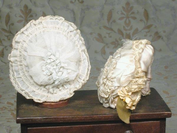 "43: TWO ANTIQUE DOLL BONNETS. (1) 17"" outside circumf"