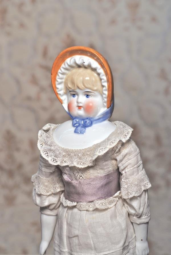 """49: FINE CHINA DOLL WITH MOLDED BONNET. 15"""". Porcel"""