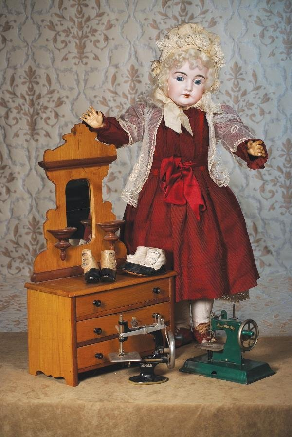 "104: ANTIQUE WOODEN DOLL DRESSER. 24""H. x 14"" W. Pi"