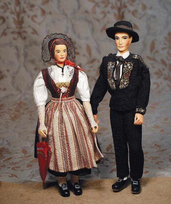 "109: PAIR CARVED SWISS WOODEN-TYPE DOLLS. 14"". Carv"