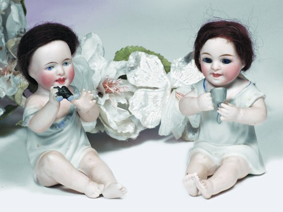 3: TWO GERMAN ALL-BISQUE BABIES IN WHITE SMOCKS.  Unmar
