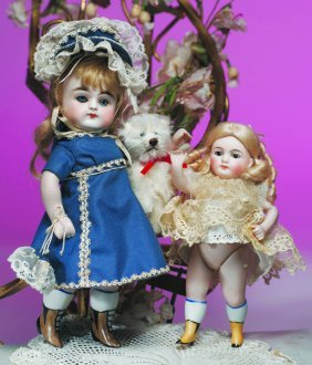 "GERMAN ALL-BISQUE DOLL WITH YELLOW BOOTS.  6"". All-"