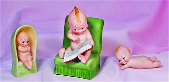 266 GERMAN BISQUE KEWPIE POSED ON STOMACH  Marks  c