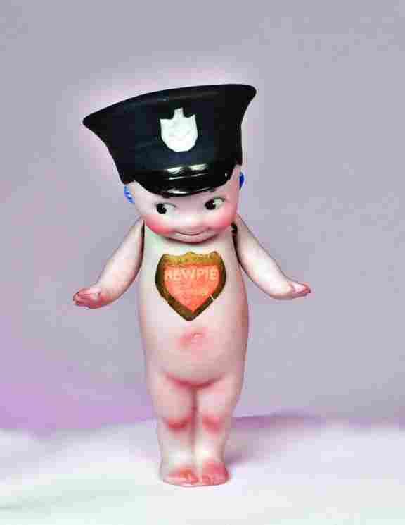"GERMAN BISQUE KEWPIE ""POLICEMAN"". Marks: Red shie"
