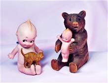 339 GERMAN BISQUE SEATED KEWPIE WITH BROWN CAT  BRO