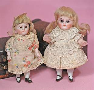 PAIR OF MINIATURE ALL-BISQUE DOLLS BY KESTNER.
