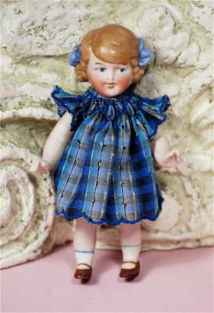 GERMAN ALL-BISQUE CHARACTER WITH BLUE HAIR BOWS BY