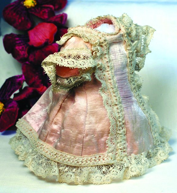 """7: ANTIQUE DOLL DRESS FOR SMALL BEBE.  4 ¼"""" L.  Pale pi"""