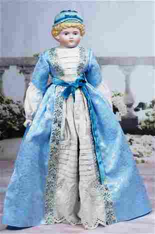 RARE GERMAN BISQUE DOLL WITH SCULPTED BLUE BONNET BY