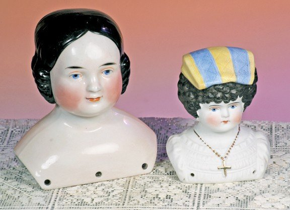 """53: PARIAN HEAD BONNET DOLL WITH MOLDED BODICE.  4"""" H."""