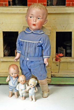 THREE ALL-BISQUE DOLLS IN BLUE SUITS. Marks: None.