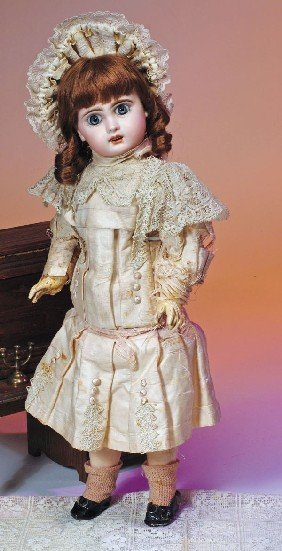 FRENCH BISQUE JUMEAU BEBE IN ORIGINAL FROCK.  Marks