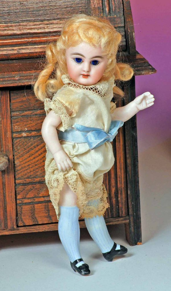 110: GERMAN ALL-BISQUE DOLL WITH SWIVEL NECK & LONG BLU
