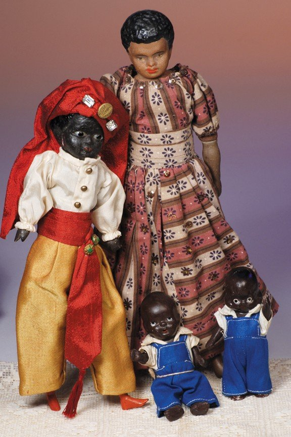 "119: COLLECTION OF FOUR BLACK DOLLS.  Includes:  11"" bi"