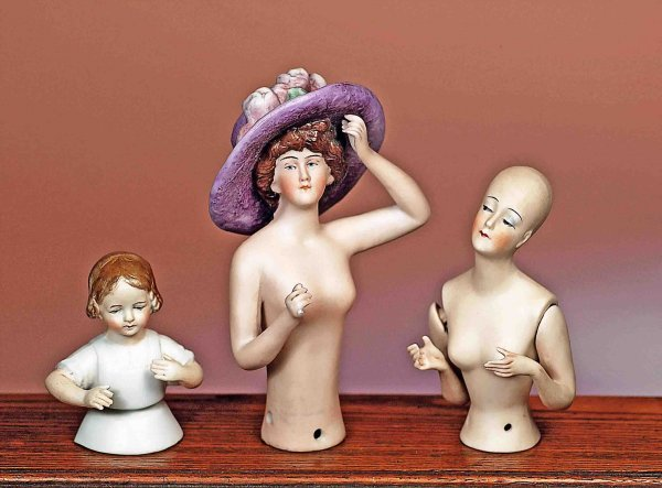 169: THREE GERMAN BISQUE HALF DOLLS WITH ARMS AWAY.  In
