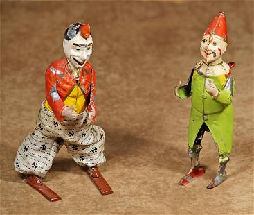 TWO TIN TOY CLOWNS ATTRIBUTED TO LEHMANN BROS