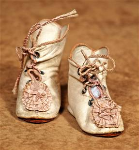 PAIR OF ANTIQUE WHITE LEATHER DOLL BOOTS