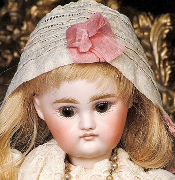20:  TINY KESTNER BISQUE DOLL WITH VERY POUTY EXPRESSIO