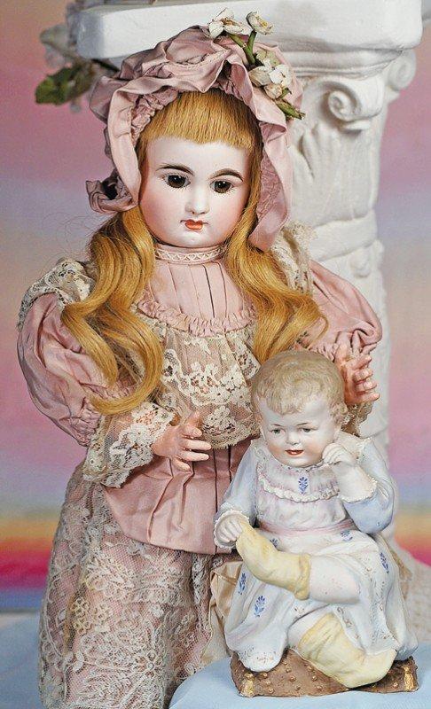 10: HEUBACH-TYPE GERMAN BISQUE FIGURINE OF BABY PULLING