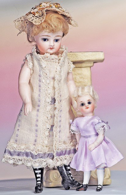 15: MINIATURE GERMAN ALL-BISQUE DOLL WITH SWIVEL NECK.
