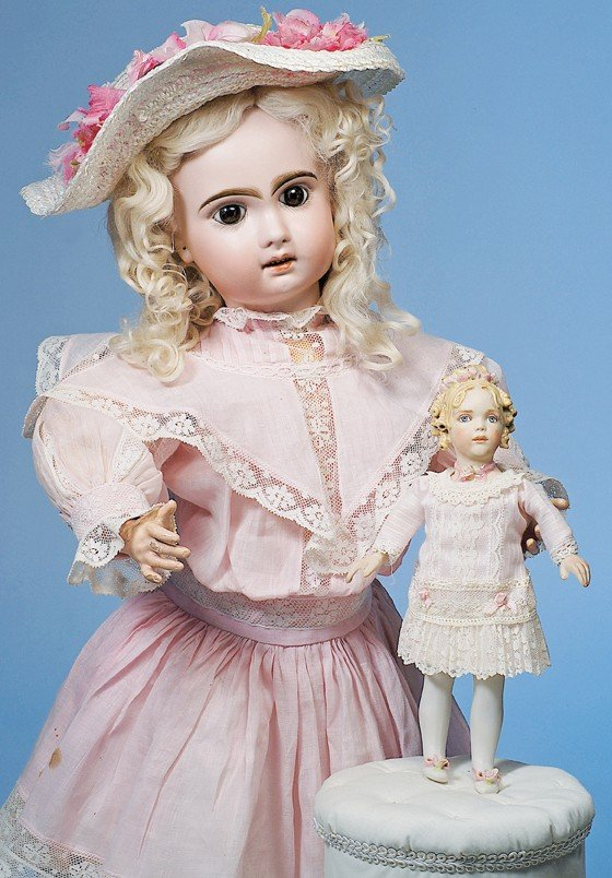 11: KATHY REDMOND BISQUE DOLL WITH LAVISH EMBELLISHMENT
