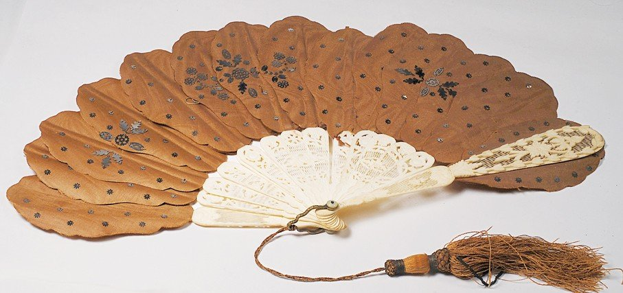 20: IVORY-HANDLED CUTWORK FAN WITH SILK TRIM