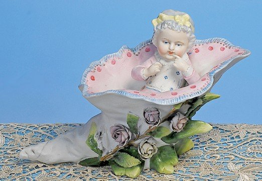 "31: GERMAN BISQUE FIGURINE OF ""BABY IN FLORAL HORN"