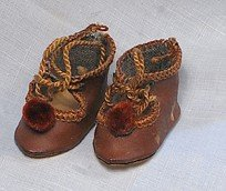 TINY PAIR OF ANTIQUE DOLL SHOES