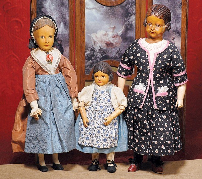 "167: TWO CARVED SWISS WOODEN CHARACTER DOLLS.  14 ½"" an"