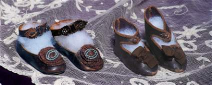 309: PAIR OF ANTIQUE FRENCH LEATHER DOLL SHOES WITH SIL