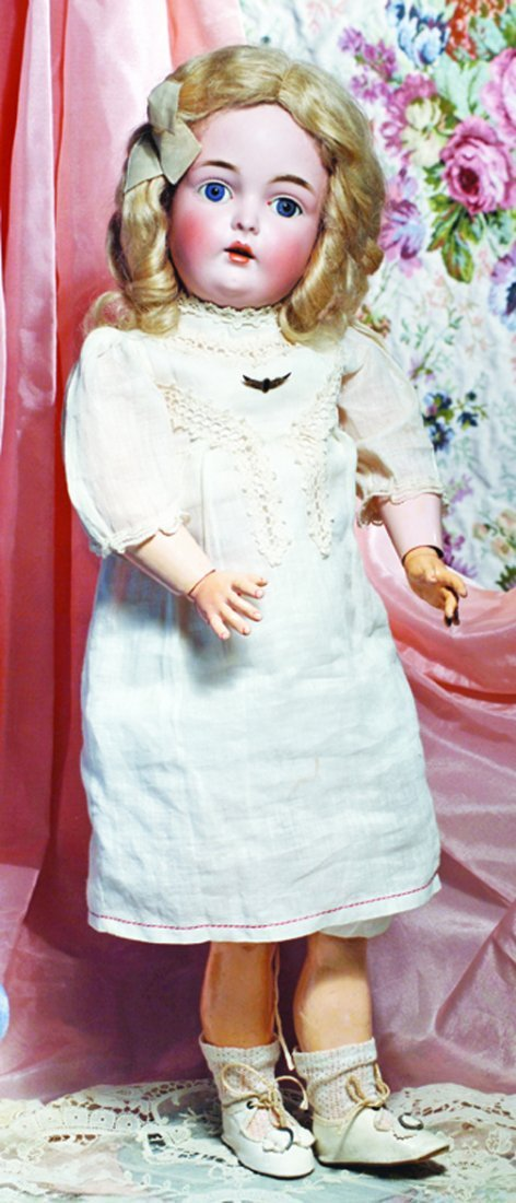 PRETTY KESTNER BISQUE CHILD DOLL IN ORIGINAL CHEMISE.