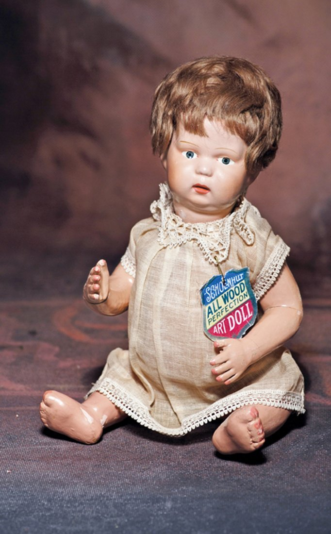 ALL-ORIGINAL SCHOENHUT CARVED WOODEN CHARACTER BABY.