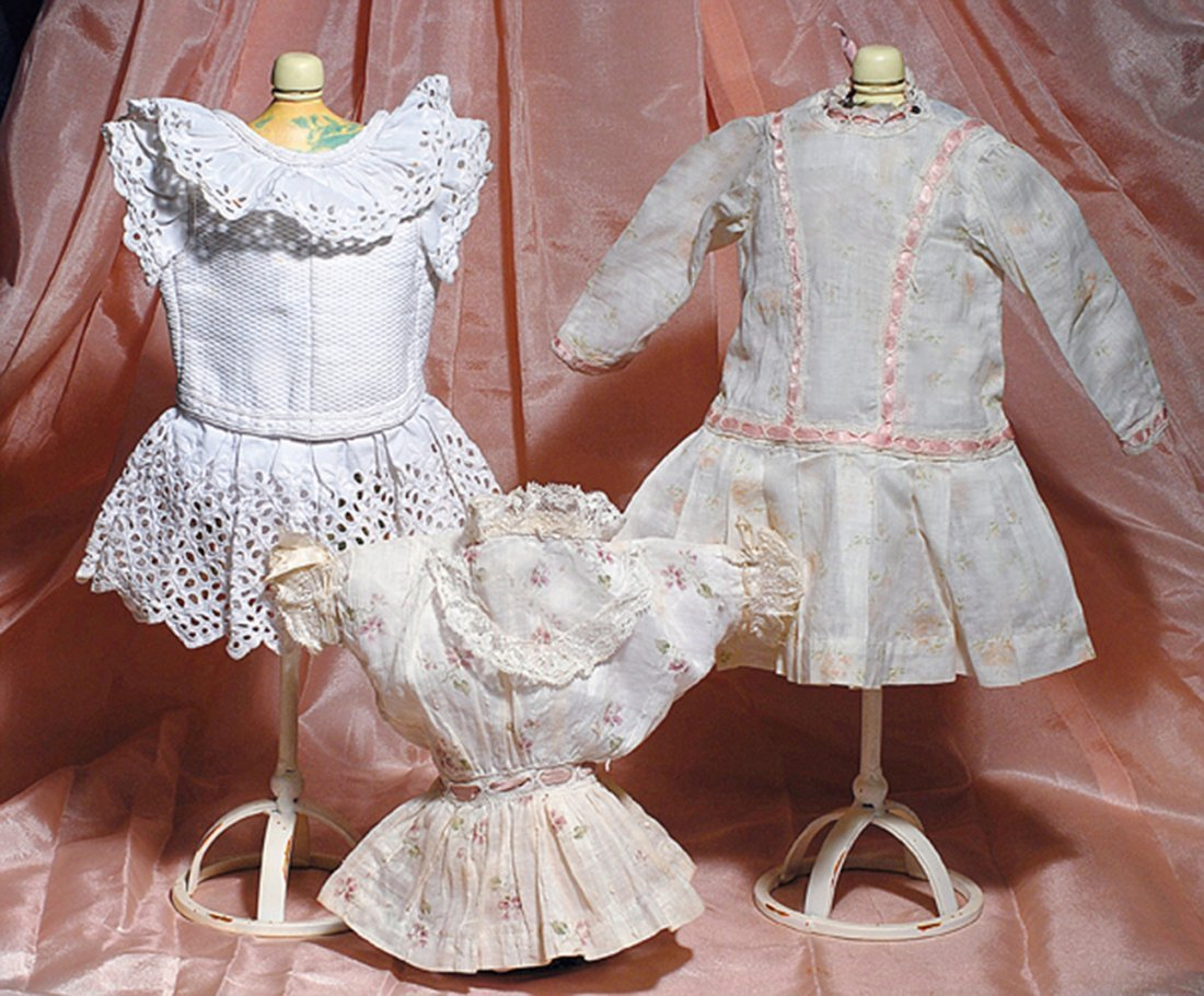 THREE ANTIQUE COTTON DRESSES FOR SMALL DOLLS.  (1)White