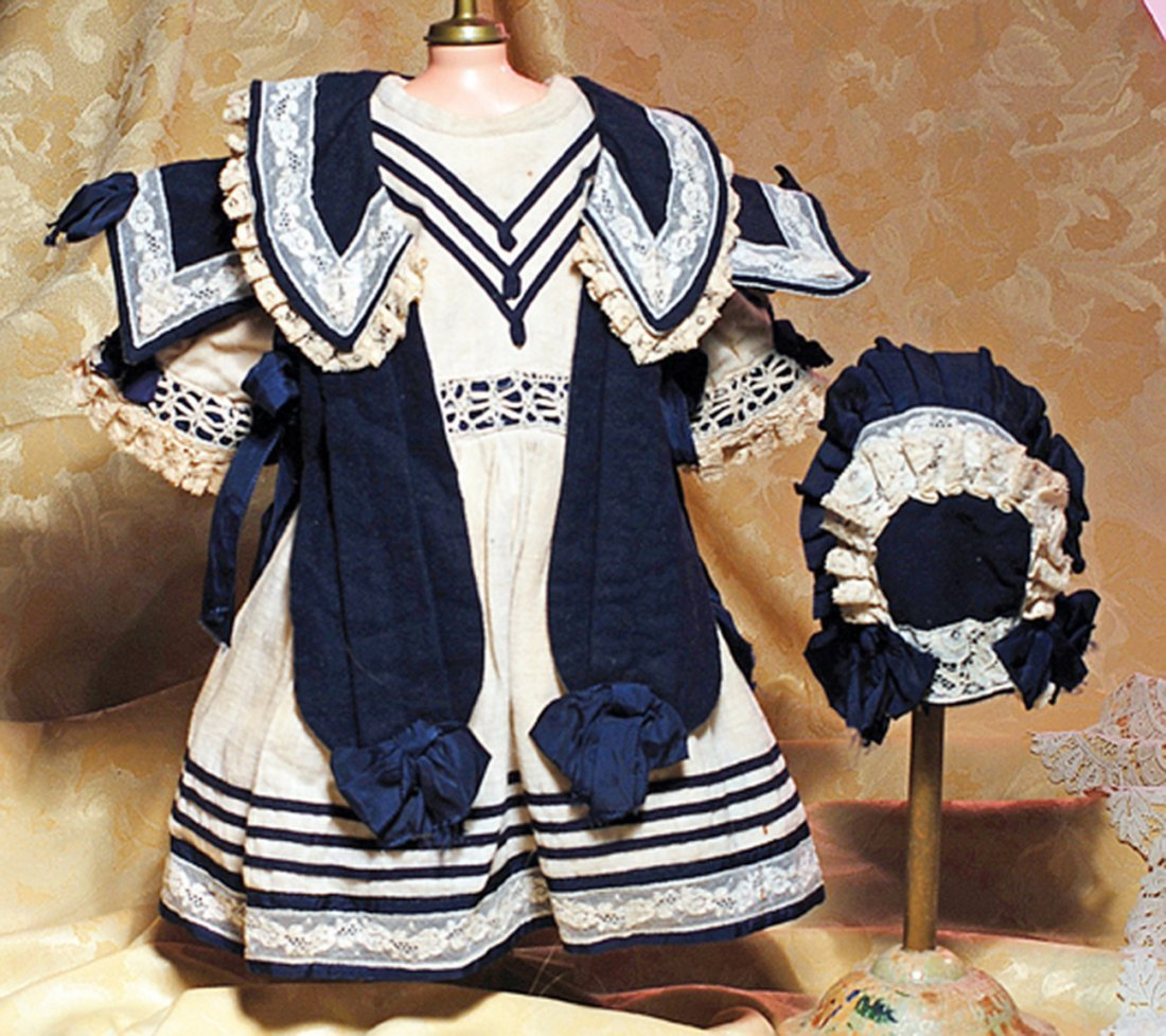 NAVY AND CREAM DOLL DRESS WITH MATCHING BONNET.  5 ½""